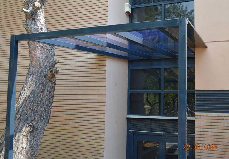 Στέγαστρο εισόδου στο Χαροκόπειο Πανεπιστήμιο Αθηνών | Tentagon